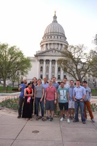 group of people in front of the WI state capitol
