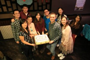 group of people with cake