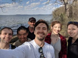 Group of people outside near a lake